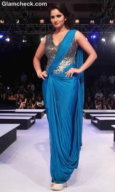 Look fabulous and attractive just like Sania Mirza with this amiable gown style designer saree. This crepe saree comes along with leather style cutwork blouse p Indian Attire, Indian Outfits, Indian Wear, Corset Blouse, Saree Gown, Net Saree, Stylish Sarees, Indian Beauty Saree, Indian Sarees