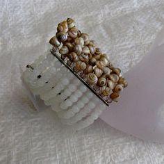 9 strands  white shell beads cuff ZAR 375
