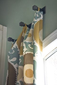 interesting way to hang curtain panels.