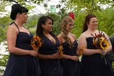 lapis bridesmaid dresses with sunflower bouquets