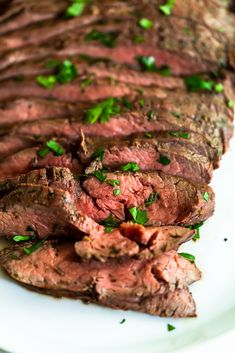 This Marinated Grilled Flank Steak will give you a juicy, flavorful flank steak with hardly any work! This flank steak marinade is easy to whisk together, and can be made a day ahead of time so you can marinate your flank steak overnight. Easy marinade | beef recipes | grilling recipes | grilled flank steak | marinated flank steak | how to cook flank steak | easy grilling recipes | fourth of july | memorial day | fathers day recipes | cookout Baked Greek Chicken, Oven Baked Chicken Parmesan, Basil Chicken, Marinated Flank Steak, Chili Garlic Sauce, Healthy Peanut Butter, Chicken Recipes, Beef Recipes, Recipe Please