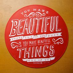 """Beautiful hand lettering painted on record: """"You make beautiful things out of the dust, You make beautiful things out of us"""""""