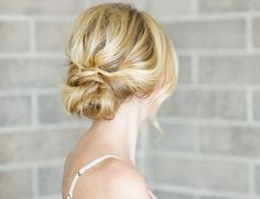 homecoming hair ideas - low loose bun with waves