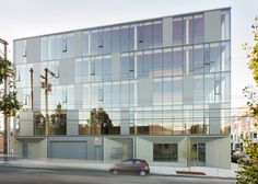 This small commercial building in Portland by Works Partnership Architecture has an engineered timber frame visible behind a glass curtain wall