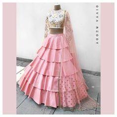 Crop top and a high waisted layered skirt is the easiest majestic outfit pick for summers. Would there be a need to mention that the two most favourite colour picks for this season ivory and blush pink team up to make it just perfect!ed 04 March 2018 Lehnga Dress, Lehenga Choli, Anarkali, Sharara, Indian Wedding Outfits, Indian Outfits, Indian Designer Outfits, Designer Dresses, Indian Gowns Dresses