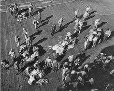 Description of  Nov. 25, 1944: Wounded sailors are treated on the flight deck of the USS Intrepid after a Japanese suicide pilot crashed his plane on the carrier's deck while it sailed off the coast of Luzon, the Philippines, during World War II. (AP Photo/U.S. Navy)