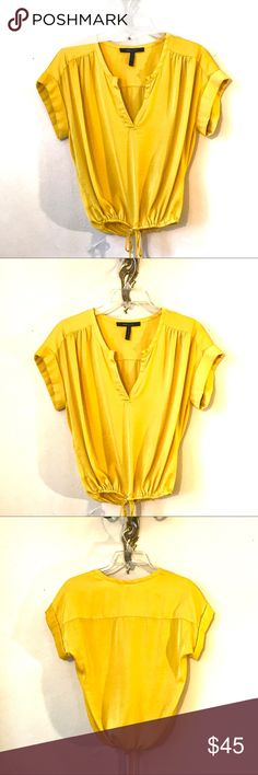 BCBG MAXAZRIA Yellow Adjustable Crop-Top Blouse This top has always been a favorite! It is Sunflower Yellow and is really beautiful on. You can wear it loose or use the drawstrings to crop it however you like. It has been worn a couple of times, but it is in very good condition with no stains or wear/tear. 100% Polyester. :) BCBGMaxAzria Tops Blouses