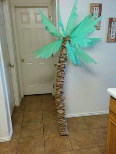 Palm Tree - (Cut out the bottoms of brown paper lunch bags, and scrunched them over a large pool noodle, folded over a green table cloth several times and drew and cut out a leaf pattern. Had some wire and used E600 glue to attach the leaves to the wire. Stuck the exposed wire from the leaves into the noodle and Walla!! A palm tree!) :) I plan on driving  a wooden stake into the ground and then slipping the pool noodle over it to hold it in place outside.
