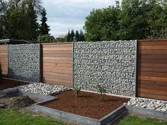 gabion and wood fence