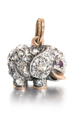A FABERGÉ JEWELLED GOLD PENDANT, WORKMASTER AUGUST HOLMSTRÖM, ST PETERSBURG, CIRCA 1900 modelled as an elephant, the surface set with rose-and circular-cut diamonds, ruby eyes and gold tusks, struck with workmaster's initials and KF in Cyrillic, 56 standard height including loop 2.2cm, 3/4 in.