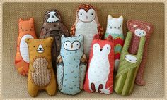 the cutest little embroidery kits you ever did see!  love the sloth!   Kirikí Press {DIY Embroidered Doll Kits}