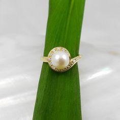 18k gouden ring met parel en diamanten