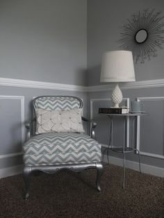"""I like the char rail,, frames, soft tones and using different textures. I""""m kind of obsessed with the idea of a gray colored living room."""