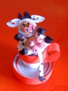 Quilled cow in a cup