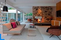 Inspiration:  Two-sided fireplace flanked by see-through cabinetry (for wine glasses and pretty things)?