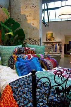 anthropologie room- the colors are so inspiring but I never find myself buying fabric like this. Perhaps it's time for a change!!!