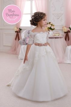 Elegant Off-The-Shoulder Flower Girl Dress. Elegant off-the-shoulder Flower Girl dress with train perfect for weddings. Features 3/4 lace sleeves and lace neckline. This beautiful little girls dress h