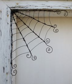 Odd Twisted Barbed Wire Corner Spider Web Reclaimed Art. $35.00, via Etsy.  Made one just like this and it is outside on the garden gate