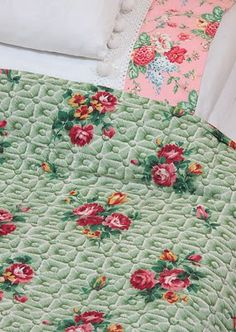 .love the green background of this rose coverlet