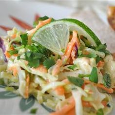 Texas Coleslaw | Cabbage salad with Southwestern twist! Tangy with lime juice, cayenne and cumin, and bursting with crunchy bits of carrot, green onion and radish. Not to be missed!