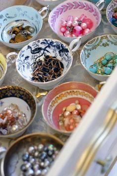 jewelry storage in vintage tea cups.