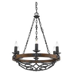 Showcasing hand-forged metal scrollwork, this eye-catching chandelier pairs Old World charm with contemporary detailing. Let it cast a warm glow as you greet...