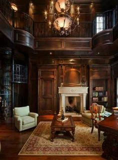 Dream home with a 2 story library complete with spiral staircase, wood burning fire place, & tall windows.