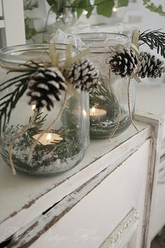 Candle holders by muriel  Little pine cone, sprig of green and a bit of snow