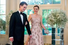 High fashion: Former Victoria's Secret model Miranda Kerr flashed a smile as she arrived at the dinner with her boyfriend, Snapchat CEO Evan Spiegel
