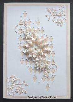By Dianne Potter: Tim Holtz Mixed Media die,cut twice,Heartfelt Creations Sun Kissed Fleur,heat embossed on vellum,Cheery Lynn flourish die....