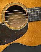 This is a 1954 00-18 Martin Guitar.  A thing of beauty