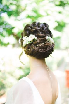 An intricate updo with small blooms will add a touch of the Mediterranean Photo Source: love my dress. #bridalhair #updo