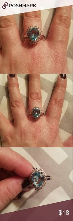 Size 9 925 Stamped SS Blue Topaz Ring Size 9 925 Stamped Sterling Silver, Blue and White Topaz Ring  I went through a little bit of an online shopping frenzy last year when I was pregnant and on bed rest with my twins for 2 months. So most of the jewelery I ordered was a size 9 which was the size I wore at the time or a 7 which is my true size. Well now my jewelry Armoires are overflowing so I'm selling a lot of things. This rings has been worn one time only and is like new. Reasonable…