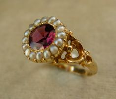 I adore this ring, utterly.  An William IV period 15ct Gold, Garnet & Seed Pearl Ring. Circa 1835.