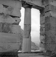 delphi, greece may 1959 the athenian treasury set includes photographs of the delphi ruins; also shots of city life in lamia, greece. from nick and maggie's spring 1959 trip to europe. part of an archival project, featuring the photographs of Nick Dewolf Delphi Greece, Great Photographers, Photo Archive, City Life, Photographs, Shots, Europe, Sky, Spring
