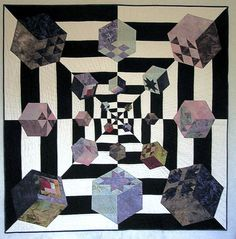 tumbling blocks quilt. ----------------------------   This deserves a BLUE RIBBON. Wow !-TD.