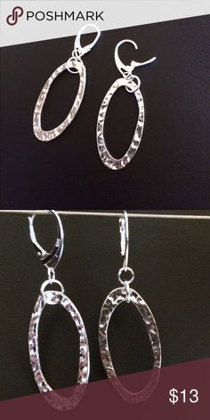 Hammered silver Sterling lever backs These are made with 925 Sterling silver lever backs. The oval hammered rings are 1 1/2 inches long and 3/4 inch across. Big look but very lightweight. These hang just short of 2 inches. If you want a little more length please ask. I can modify them for you. Jewelry Earrings