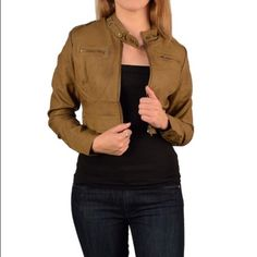 Short jacket Front zip, twin button neck. Brown. Model is wearing a small. Model measurements bust 34, waist 26. 100% polyurethane. Med 5/9 Jackets & Coats