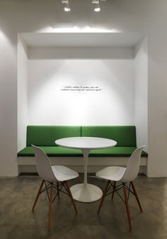 Leo Burnett office, Singapore by Ministry of Design | Sofa built into nook with lowered ceiling. Small table and chairs nearby