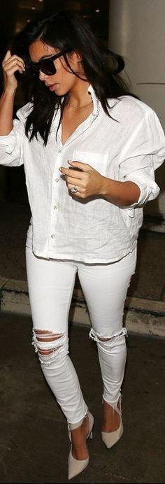 Who made Kim Kardashian's white ripped jeans, pumps, and black sunglasses?