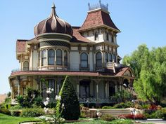 love the fanciful turret!  this would be my reading room...