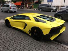 Lamborghini Aventador Coupe painted in Giallo w/ a Lamborghini Aventador Super Veloce body kit   Photo taken by: @hkssky on Instagram
