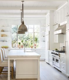 Rustic white kitchen with brass pendants via velvet and linen