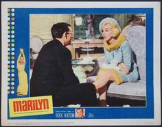 """Marilyn Monroe and Wally Cox on a US lobby card for the biopic film """"Marilyn"""", released a year after MM's death and paying tribute to her life and career, narrated by Rock Hudson, 1963. Card #1 in a series of 8."""