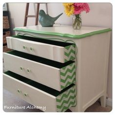 Dresser/changing table painted in Annie Sloan chalk paint in Old White with custom green (English yellow and Antibes mix) with chevron stripe