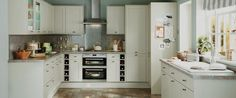 Greenwich Shaker Grey A grey Shaker style door. extra tall wall units and bespoke shelving. Shaker Style Doors, Shaker Style Kitchens, Shaker Kitchen, New Kitchen, Kitchen Dining, Kitchen Cabinets, Kitchen Ideas, Kitchen Inspiration, Howdens Kitchens