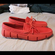 Swims rubber lace loafer orange summer shoe mens Brand new never worn. Swims rubber loafers orange with white sole. Size 9 men. Great for summer. Has a ton of features. Bought at saks last year and never worn. 100% waterproof with antibacterial lining to prevent odors. Excellent pair of boat water shoes. Very stylish. Retails $160 Swims Shoes Flats & Loafers