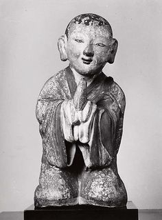 Kneeling Korean Priest with clasped hands. 18th C. 17 inches high. Clay and polychrome. Joseon dynasty