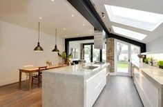 Monochrome, Wood, Kitchen Inspo, Queens Park kitchen extension love the polished concrete counters, again the hob and sink are in the island. Kitchen Living, New Kitchen, Kitchen Wood, Kitchen Ideas, Kitchen Black, Kitchen Layout, Kitchen Sink, Stairs Kitchen, Kitchen Island