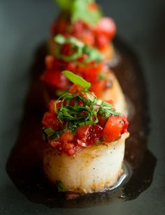 Caramelized scallops with strawberry salsa.